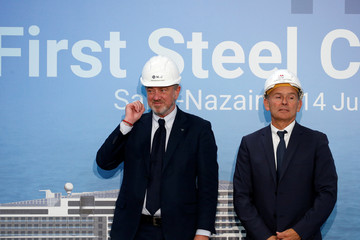 Pierfrancesco Vago, Executive Chairman of MSC Cruises and Laurent Castaing, President of STX France, attend a ceremony at the STX France shipyard site in Saint-Nazaire