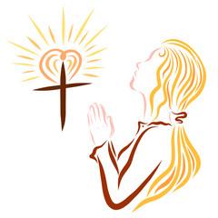 Young Christian prays to God, cross, heart and shining sun