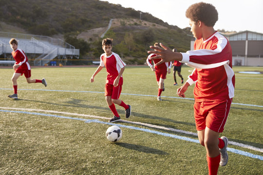 Group Of Male High School Students Playing In Soccer Team