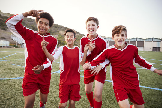 Portrait Of Male High School Soccer Team Celebrating