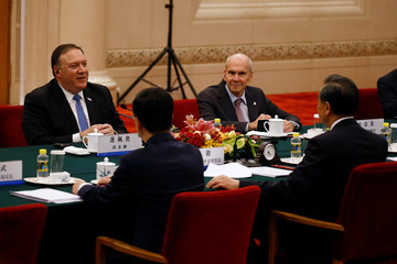 U.S. Secretary of State Mike Pompeo talks to Chinese Foreign Minister Wang Yi during a meeting at the Great Hall of the People in Beijing