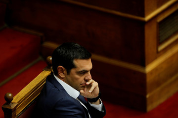 Greek PM Tsipras attends a parliamentary session ahead of a debate on a motion of no confidence by the main opposition in row over a deal on neighbouring Macedonia's name