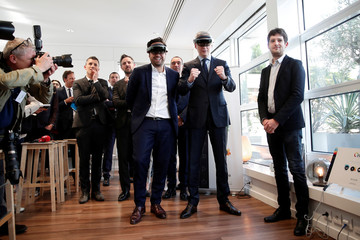Mounir Mahjoubi, French Junior Minister in Charge of Digital Sector, and French Finance Minister Bruno Le Maire wear virtual reality headsets during a visit of the new Qwant headquarters in Paris