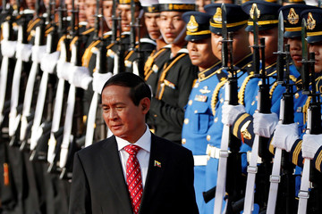 Myanmar's president Win Myint reviews the honor guard during his welcome ceremony at the Government House in Bangkok