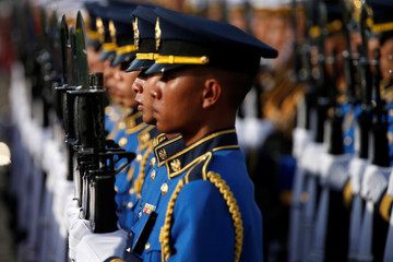 Honor guards prepare for the welcome ceremony of Myanmar's President Win Myint, before he meets with Thailand's Prime Minister Prayut Chan-o-cha, at the Government House in Bangkok