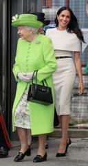 Britain's Queen Elizabeth and Meghan, the Duchess of Sussex, arrive in Runcorn