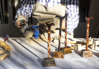 traditional handicrafts. man carving cane