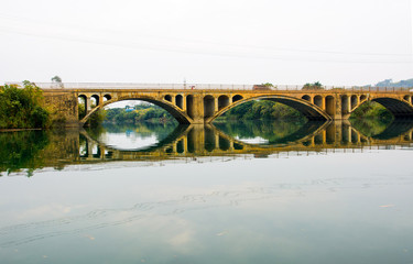 Vintage bridge in China reflected in the lake