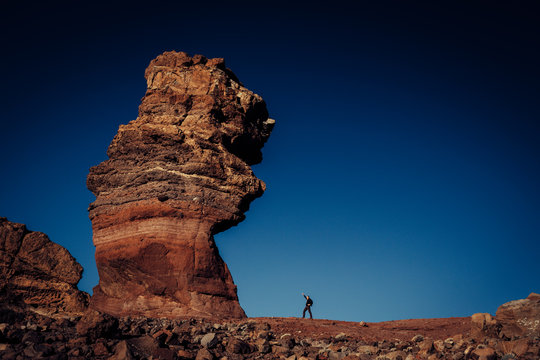 Big rock formation of Los Roques de Garcia compare with small human, Teide National Park, Tenerife, Spain. Winners concept.