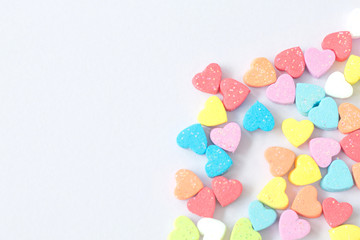 Sweet mini hearts in colorful on pastel  background