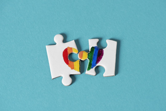 puzzle pieces about to form a rainbow heart.