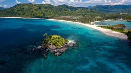 Aerial drone view of beautiful tropical beaches, small islands and surrounding coral reef (Nacpan Beach) Wall mural