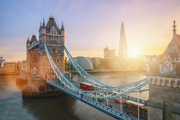 Foto auf Gartenposter London roten bus Sunset at the Tower Bridge in London, the UK