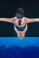 Young female diver preparing for jump