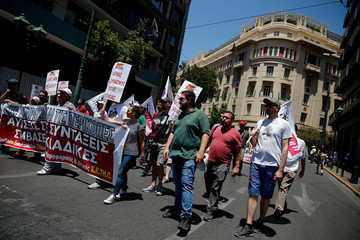 Members from the communist-affiliated trade union PAME take part in a protest against austerity in Athens