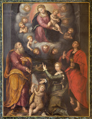 REGGIO EMILIA, ITALY - APRIL 13, 2018: The painting of Madonna with the st. Joseph, John the Evangelist and Cecilia by regional unknown artist of 16. cent.