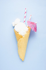 Soft and sweet / Creative concept photo of marshmallow ice cream on blue background.