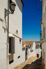 Narrow street in old town of Ronda, Andalusia, Spain.