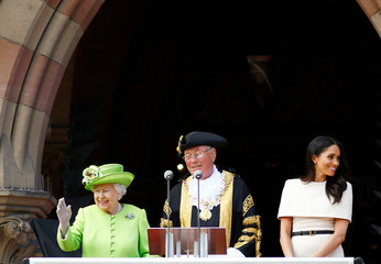 Britain's Queen Elizabeth and Meghan, the Duchess of Sussex, visit the town hall in Chester