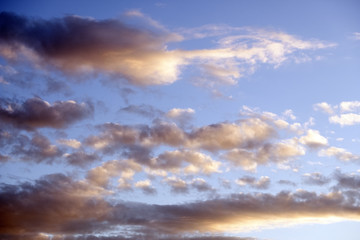 Evening blue sky with clouds. Beautiful sunset.