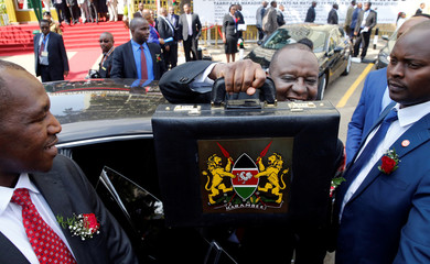 Kenya's Cabinet Secretary of National Treasury Henry Rotich holds up a briefcase containing the Government Budget for the 2018/19 fiscal year in Nairobi