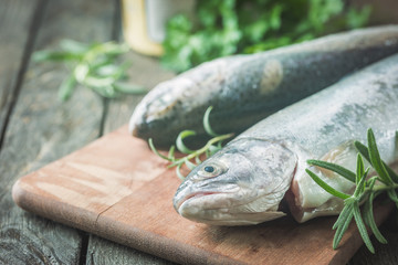Two rainbow trout on a board
