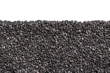 Fototapeta Ziarna czarnego sezamu. Tło z ziaren z pustą przestrzenią na górze. Tekstura z czarnych nasion. obraz
