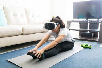 Woman learning yoga poses through virtual reality