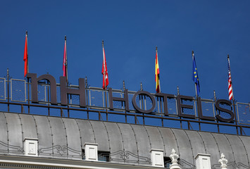 The NH Hotel logo is seen on top of the NH Madrid Nacional hotel in Madrid