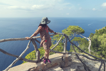 Curly woman and picturesque view at Torre del Verger. Majorca