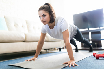 Woman doing push ups in living room