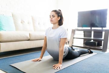 Woman practising cobra pose yoga