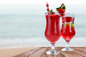 Summer time and glasses of drink on wooden table.
