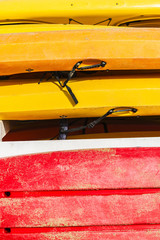 Heap of yellow and red kayaks as abstract background