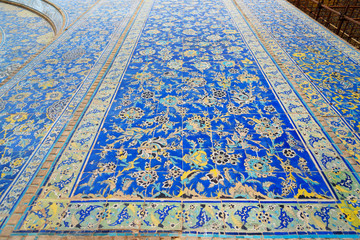 Decorated with colorful tiles of Shah Mosque or Imam Mosque in Isfahan. Iran