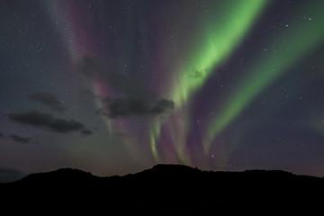Northern Lights - Aurora borealis. Beautiful picture of massive multicoloured green vibrant Aurora Borealis in the night sky