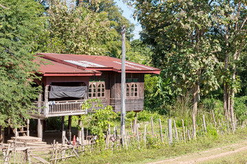 Typical house in the rural Laos at the banks of Mekong riiver.