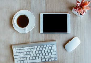 tablet and keyboard with coffee cup  on wooden table background