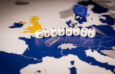 EU flag and graphene word over a map of europe, suitable as transparent flexible future graphene use or Graphene Flagship, Europe's biggest ever research initiative