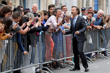 Stephane Bern, the French President's special cultural adviser and a French TV host, greets people in Rochefort