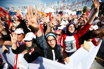 Supporters of Turkish President Tayyip Erdogan react during an election rally in Yalova
