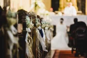Wedding ceremony in a church, hallway behind