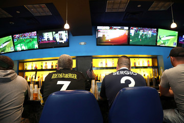 Gamblers watch sports on televisions at Monmouth Park Sports Book by William Hill, shortly after the opening of the first day of legal betting on sports in Oceanport