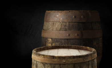 Wall Mural - Beer barrel with beer glass on table on wooden background
