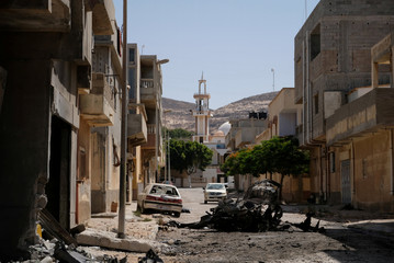 A view of destroyed buildings and cars after the street was controlled by forces loyal to Libyan commander Khalifa Haftar in Derna