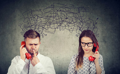 confused couple woman and man talking on the phone exchanging with many negative thoughts