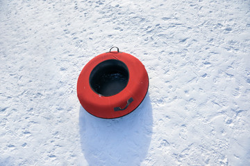 Top view of inflatable snow tube on snowy background