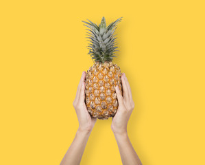 Creative Ripe pineapple on yellow background. fruit for tropical.