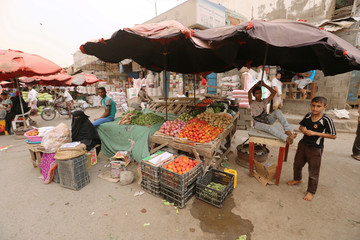 Street vendors sell vegetables in the Red Sea port city of Hodeidah