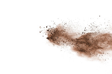 Brown powder explosion isolated on white background.